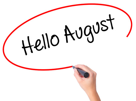 Women Hand writing Hello August with black marker on visual screen. Isolated on white. Business, technology, internet concept. Stock Photo