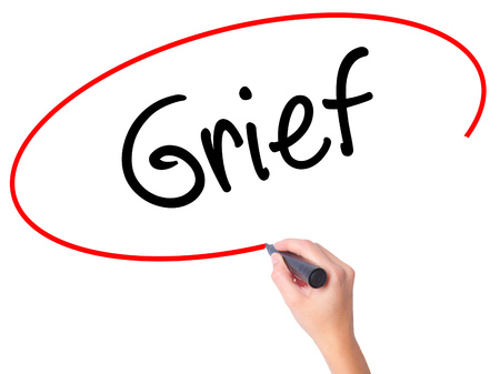 Women Hand writing Grief with black marker on visual screen. Isolated on white. Business, technology, internet concept. Stock Photo Stock Photo