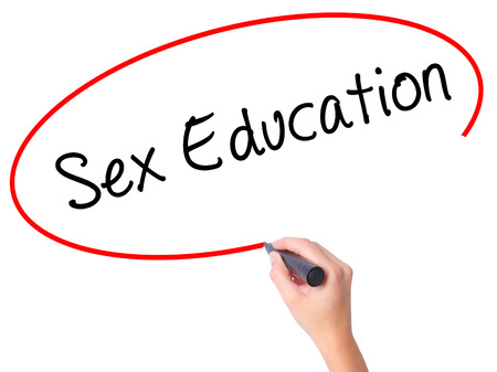 sex education: Women Hand writing Sex Education with black marker on visual screen. Isolated on white. Business, technology, internet concept. Stock Photo