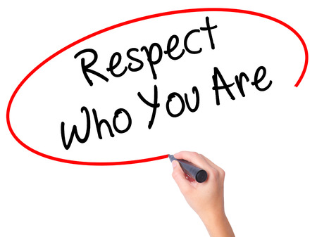 Women Hand writing Respect Who You Are with black marker on visual screen. Isolated on white. Business, technology, internet concept. Stock Photo