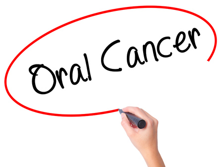 oral cancer: Women Hand writing Oral Cancer  with black marker on visual screen. Isolated on white. Business, technology, internet concept. Stock Photo Stock Photo