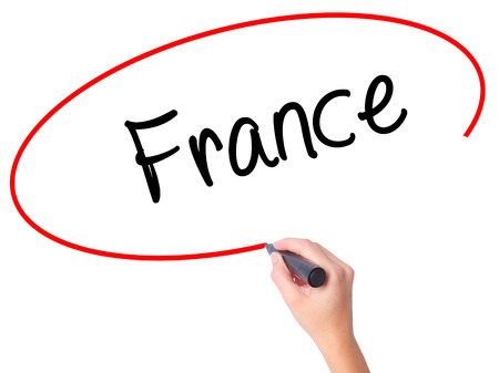Women Hand writing France with black marker on visual screen. Isolated on white. Business, technology, internet concept. Stock Photo
