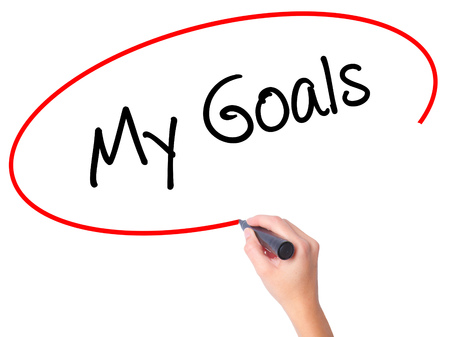 Women Hand writing  My Goals with black marker on visual screen. Isolated on white. Business, technology, internet concept. Stock Photo