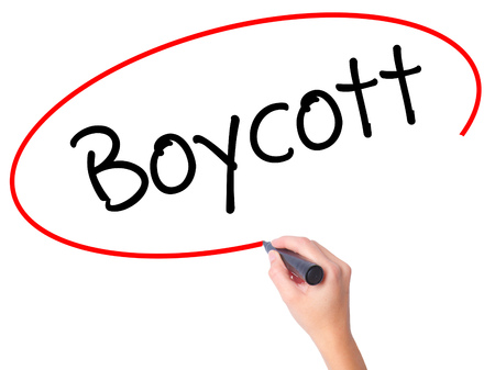 denying: Women Hand writing Boycott with black marker on visual screen. Isolated on white. Business, technology, internet concept. Stock Photo