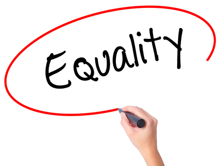 parity: Women Hand writing Equality  with black marker on visual screen. Isolated on white. Business, technology, internet concept. Stock Photo Stock Photo