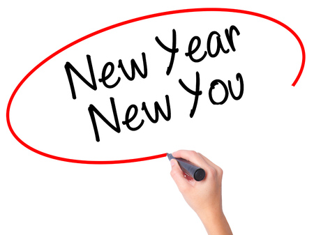 carrer: Women Hand writing New Year New You with black marker on visual screen. Isolated on city. Business, technology, internet concept. Stock Photo