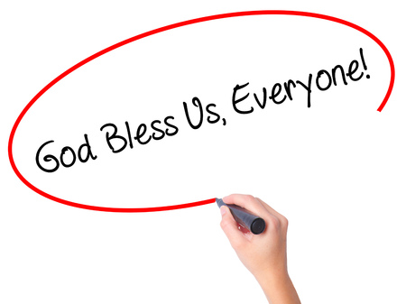 preachment: Women Hand writing God Bless Us, Everyone! with black marker on visual screen. Isolated on white. Business, technology, internet concept. Stock Photo