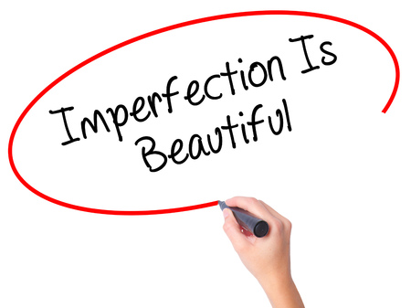 perfectionist: Women Hand writing Imperfection Is Beautiful with black marker on visual screen. Isolated on white. Business, technology, internet concept. Stock Photo Stock Photo