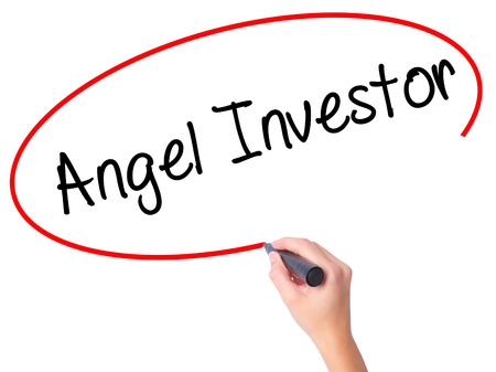 Women Hand writing Angel Investor with black marker on visual screen. Isolated on white. Business, technology, internet concept. Stock Photo
