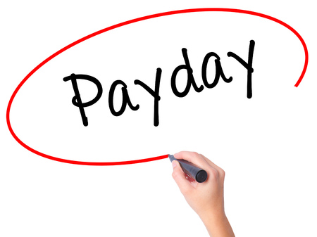 Women Hand writing Payday with black marker on visual screen. Isolated on white. Business, technology, internet concept. Stock Photo
