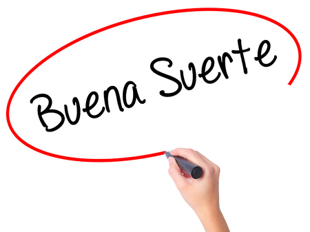 goodluck: Women Hand writing Buena Suerte( Good Luck in Spanish) with black marker on visual screen. Isolated on white. Business, technology, internet concept. Stock Photo