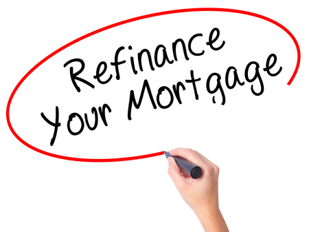 loaning: Women Hand writing Refinance Your Mortgage with black marker on visual screen. Isolated on white. Business, technology, internet concept. Stock Image