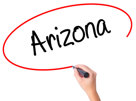 Women Hand writing  Arizona  with black marker on visual screen. Isolated on white. Business, technology, internet concept. Stock Photo Stock Photo