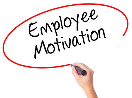 induce: Women Hand writing Employee Motivation with black marker on visual screen. Isolated on white. Business, technology, internet concept. Stock  Photo