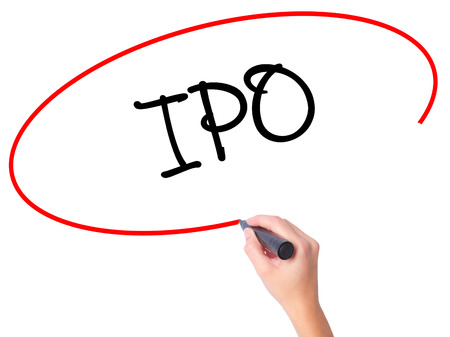 public offering: Women Hand writing IPO (Initial Public Offering)   with black marker on visual screen. Isolated on white. Business, technology, internet concept. Stock Photo
