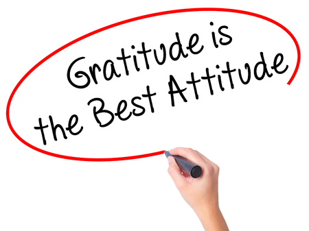 positiveness: Women Hand writing Gratitude is the Best Attitude with black marker on visual screen. Isolated on white. Business, technology, internet concept. Stock Photo Stock Photo