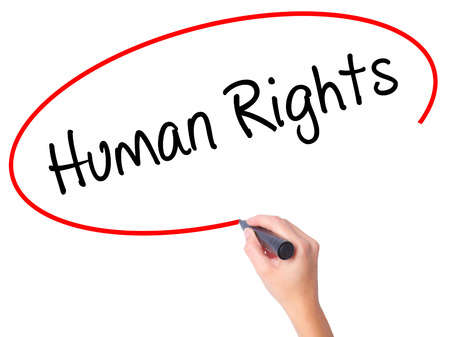 norms: Women Hand writing Human Rights with black marker on visual screen. Isolated on white. Business, technology, internet concept. Stock Photo Stock Photo