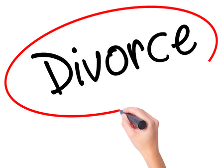 ex wife: Women Hand writing Divorce  with black marker on visual screen. Isolated on white. Business, technology, internet concept. Stock Photo Stock Photo