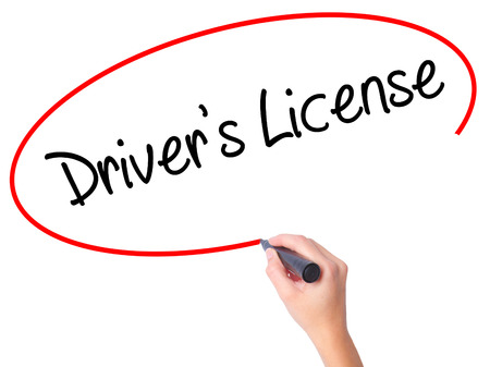drivers license: Women Hand writing Drivers License with black marker on visual screen. Isolated on white. Business, technology, internet concept. Stock Photo Stock Photo
