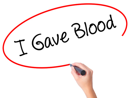 gave: Women Hand writing I Gave Blood with black marker on visual screen. Isolated on white. Business, technology, internet concept. Stock Photo