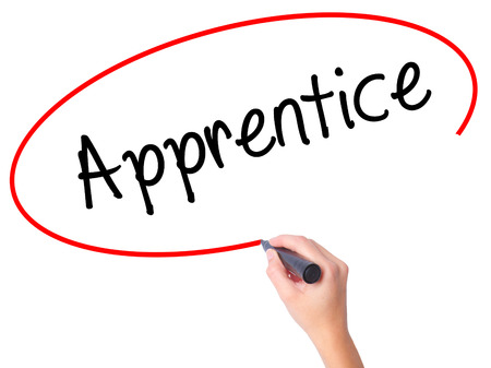 apprenticeship employee: Women Hand writing Apprentice with black marker on visual screen. Isolated on white. Business, technology, internet concept. Stock Photo