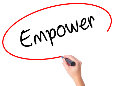Women Hand writing Empower with black marker on visual screen. Isolated on white. Business, technology, internet concept. Stock Photo