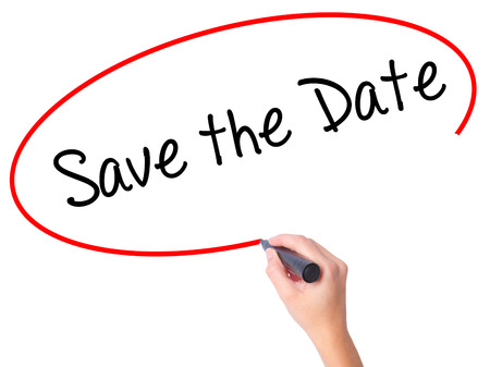 Women Hand writing Save the Date  with black marker on visual screen. Isolated on white. Business, technology, internet concept. Stock Photo Standard-Bild