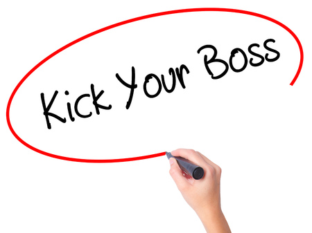Women Hand writing Kick Your Boss with black marker on visual screen. Isolated on white. Business, technology, internet concept. Stock Photo