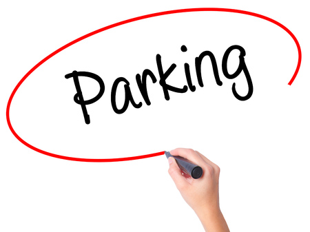 Women Hand writing Parking with black marker on visual screen. Isolated on white. Business, technology, internet concept. Stock Photo