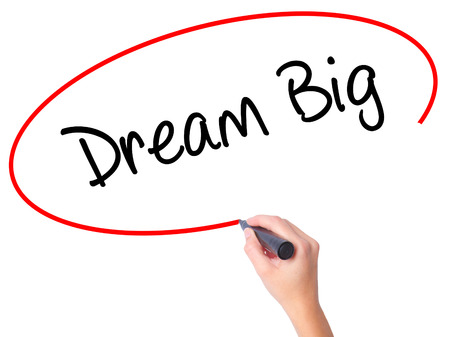 Women Hand writing Dream Big  with black marker on visual screen. Isolated on white. Business, technology, internet concept. Stock Photo