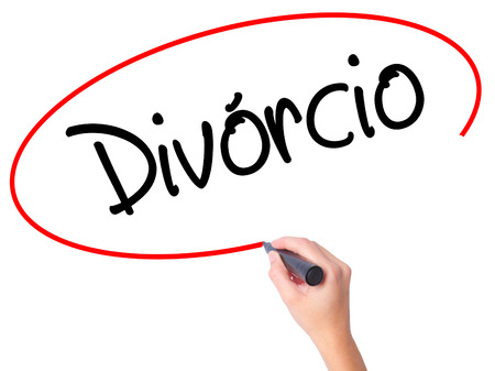 splitting up: Women Hand writing Divorcio (Divorce in Portuguese) with black marker on visual screen. Isolated on white. Business, technology, internet concept. Stock Photo