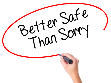 better safe than sorry: Women Hand writing Better Safe Than Sorry with black marker on visual screen. Isolated on white. Business, technology, internet concept. Stock Photo Stock Photo