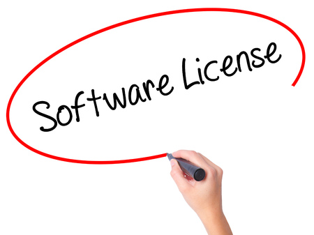 linker: Women Hand writing Software License with black marker on visual screen. Isolated on white. Business, technology, internet concept.
