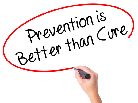 cure prevention: Women Hand writing Prevention is Better than Cure with black marker on visual screen. Isolated on white. Business, technology, internet concept. Stock Photo Stock Photo