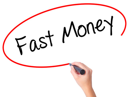 Women Hand writing Fast Money  with black marker on visual screen. Isolated on white. Business, technology, internet concept. Stock Photo