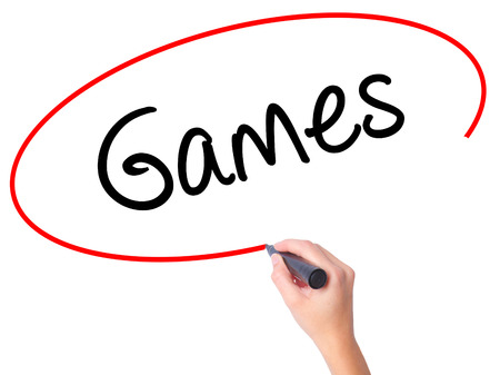 Women Hand writing Games with black marker on visual screen. Isolated on white. Business, technology, internet concept. Stock Photo
