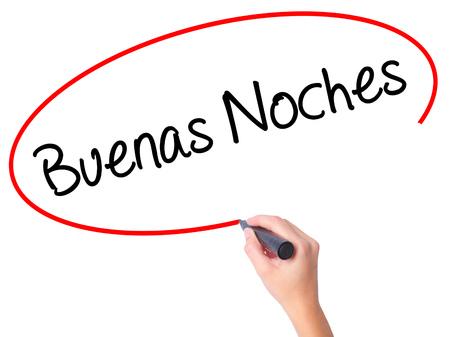 Mujeres escribiendo a mano Buenas Noches (Buenas noches en español) con marcador negro en la pantalla visual. Aislado en blanco Negocios, tecnología, concepto de internet. Foto de stock