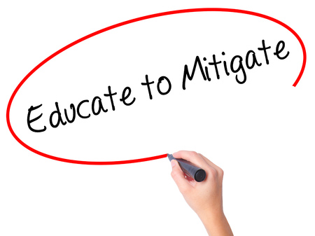 mitigate: Women Hand writing Educate to Mitigate with black marker on visual screen. Isolated on white. Business, technology, internet concept. Stock Photo