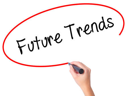 Women Hand writing Future Trends with black marker on visual screen. Isolated on white. Business, technology, internet concept.