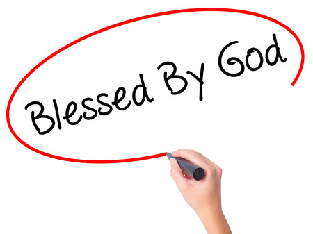 preachment: Women Hand writing Blessed By God with black marker on visual screen. Isolated on white. Business, technology, internet concept. Stock Photo Stock Photo
