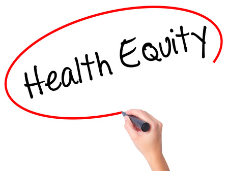 health equity: Women Hand writing Health Equityt with black marker on visual screen. Isolated on white. Business, technology, internet concept. Stock Photo