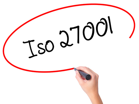 Women Hand writing Iso 27001  with black marker on visual screen. Isolated on white. Business, technology, internet concept. Stock Photo Stock Photo