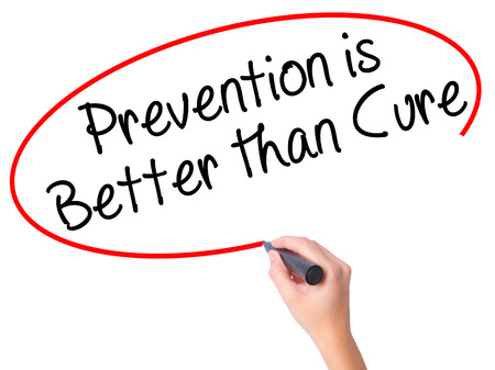 cure prevention: Women Hand writing Prevention is Better than Cure with black marker on visual screen. Isolated on white. Business, technology, internet concept. Stock Image