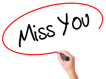 Women Hand writing Miss You with black marker on visual screen. Isolated on white. Business,  technology, internet concept. Stock Photo