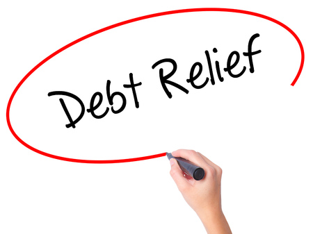 Women Hand writing Debt Relief with black marker on visual screen. Isolated on white. Business, technology, internet concept. Stock Photo Stock Photo