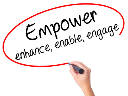 enable: Women Hand writing Empower enhance, enable, engage with black marker on visual screen. Isolated on white. Business, technology, internet concept. Stock Photo