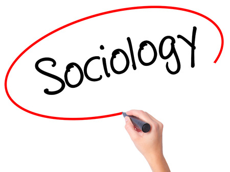 sociologia: Women Hand writing Sociology  with black marker on visual screen. Isolated on white. Business, technology, internet concept. Stock Photo