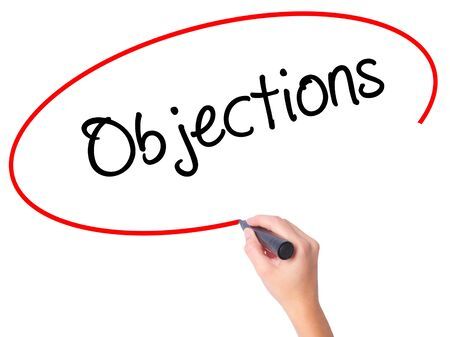 objections: Women Hand writing Objections  with black marker on visual screen. Isolated on white. Business, technology, internet concept. Stock Photo Stock Photo