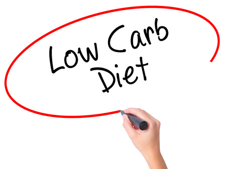 low carb diet: Women Hand writing Low Carb Diet with black marker on visual screen. Isolated on white. Business, technology, internet concept. Stock Photo Stock Photo