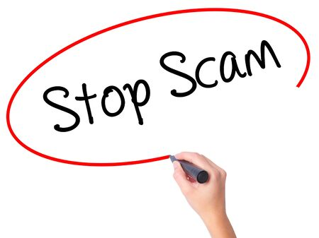 Women Hand writing Stop Scam with black marker on visual screen. Isolated on white. Business, technology, internet concept. Stock Photo Stock Photo